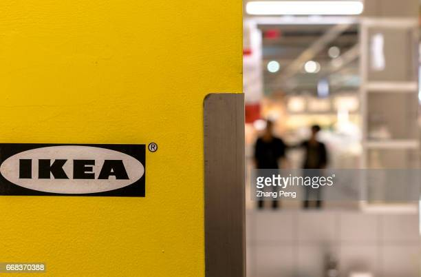 People choose furnitures in an IKEA shop Ikea's global profits rose by 20% in 2016 as it made gains in the Chinese market