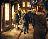 People Christmas shopping on a old fashioned street in York