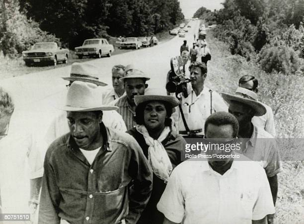 June 1966 Hernando Mississippi American comedian Dick Gregory with wife and friends on a march from the spot where James Meredith was shot James...