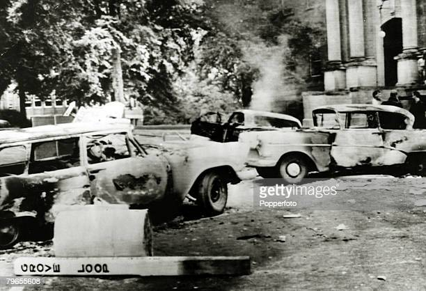 October 1962 Oxford Mississippi Burnt out cars after violence when rioters protested against the enrollment of James Meredith the first black student...