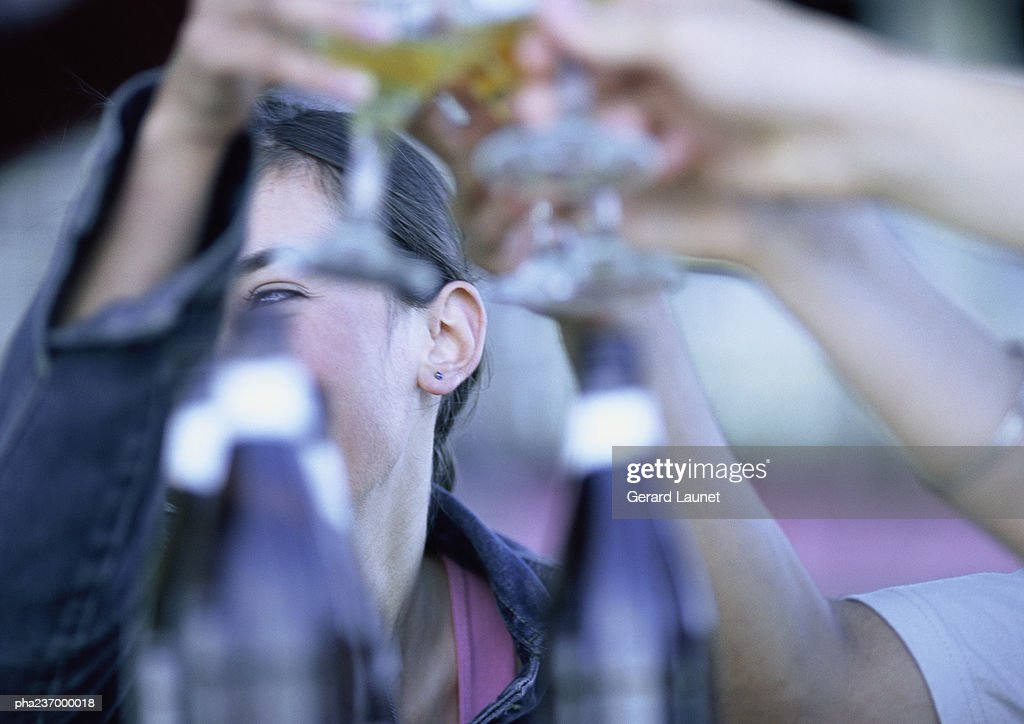 People clanking glasses together, close-up. : Stockfoto