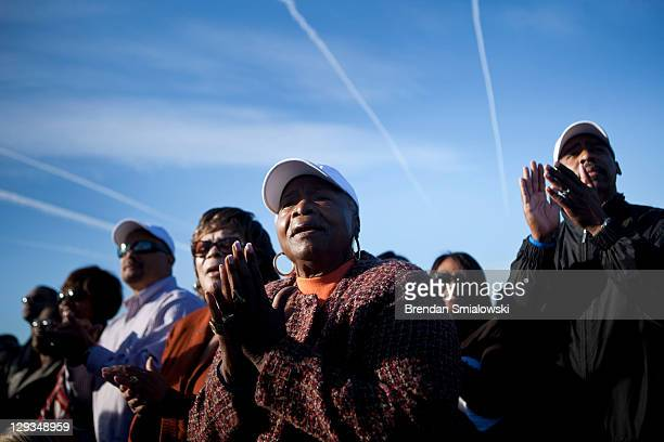 People clap during a dedication ceremony at the Martin Luther King Memorial on the National Mall October 16 2011 in Washington DC President Barack...