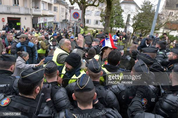 People clash with gendarmes as they protest against French president's visit for a second meeting gathering some 600 mayors who will relay the...