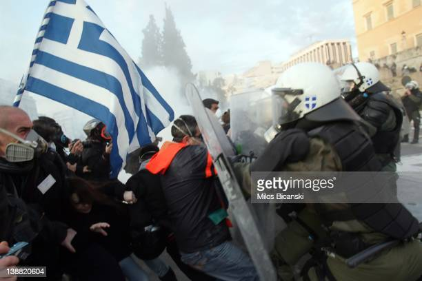 People clash with police in the streets during a demonstration against the new austerity measures on February 12 2012 in Athens Greece Greece's...