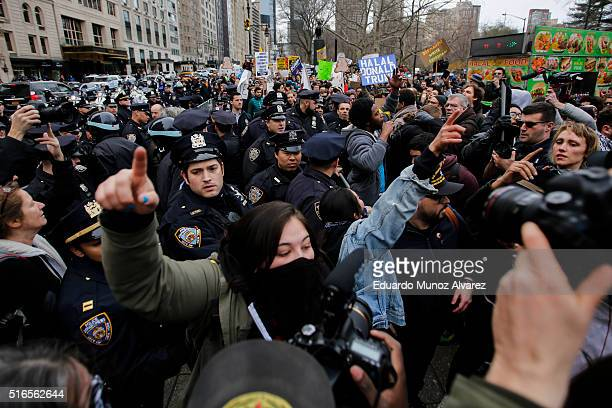 People clash with protesters while they take part in a march against Republican presidential candidate Donald Trump on March 19 2016 in New York City...