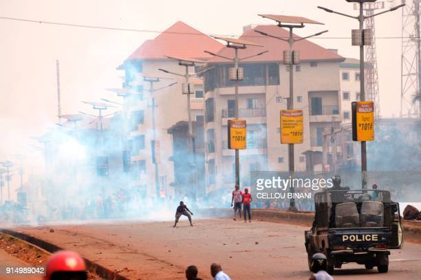People clash with riot police during a demonstration against the results of the local elections on February 6 2018 in Conakry Guinean opposition...