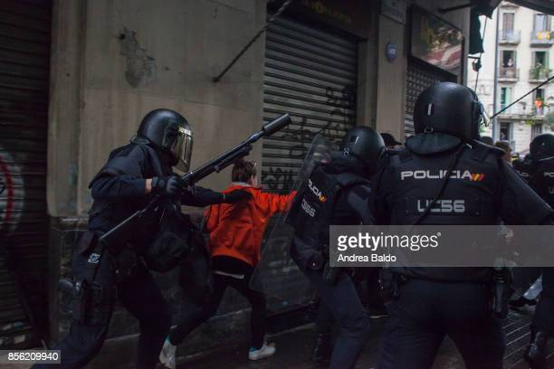 People clash with the Spanish police 'Policia Nacional' after they closed down a polling station Today the referendum was held to vote for the...