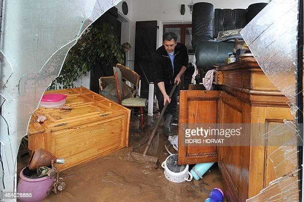 People clean their house on Januray 20 2014 in La LondelesMaures southeastern France River levels were receding early today in southeastern France...