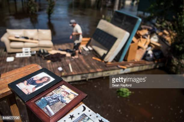 People clean up as floodwaters from the Hurricane Irma recede September 13 2017 in Middleburg Florida Floodwaters in town from the Black Creek topped...