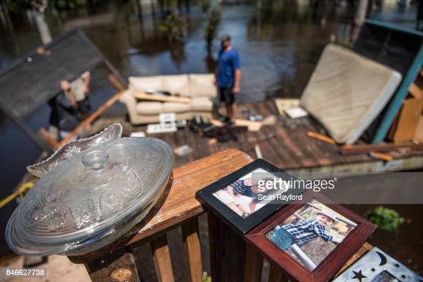 People clean up as floodwaters from the Hurricane Irma recede September 13 2017 in Middleburg Florida Flooding in town from the Black Creek topped...