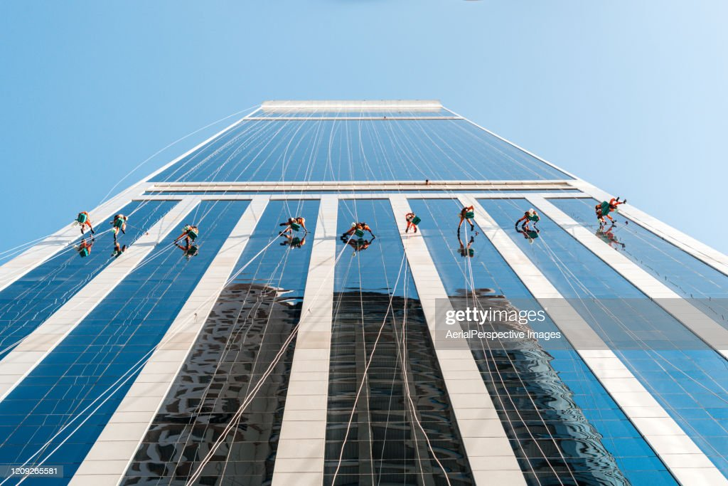 People Cleaning the City Building / Dubai, UAE : Stock Photo