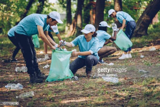 people cleaning the environment - volunteer stock pictures, royalty-free photos & images