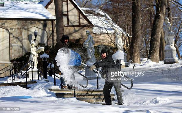 People clear snow after the winter storm Janus Connecticut United States January 22 2014 Janus left 4 deaths and dropped over 30cm snow in...