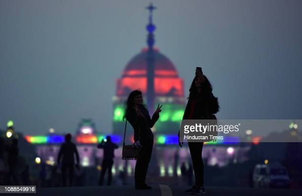 People click selfie with illuminated Rashtrapati Bhavan in the backdrop ahead of Republic Day 2019 celebrations at Vijay chowk in New Delhi India on...