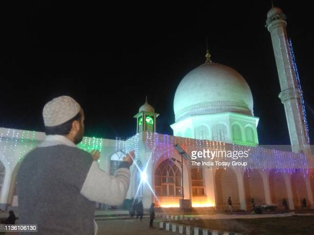 People clicked offering prayers on the occassion of ShabeMeraj at Hazratbal in Srinagar