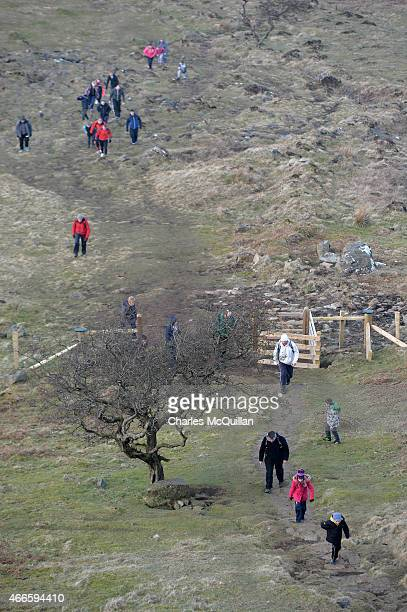 People climb Slemish as hundreds of people make the St. Patrick's Day pilgrimage to the top of the mountain on March 17, 2015 in Ballymena, Northern...