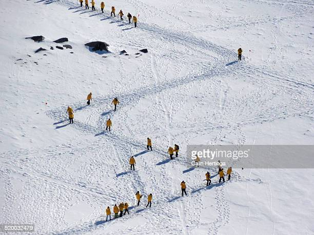 People climbing a mountain in zigzag