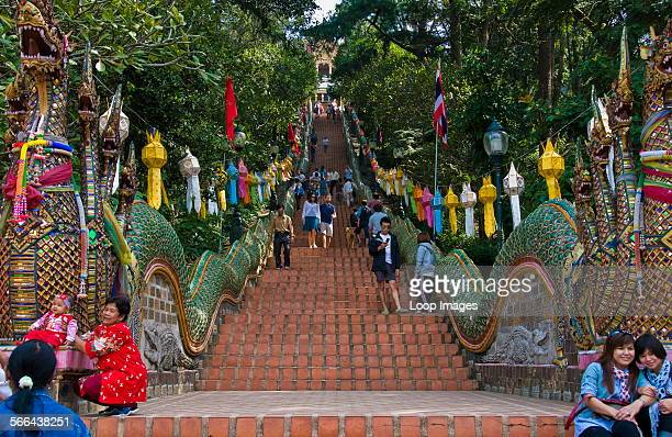 People climbing and descending the 300 steps up to Wat Phra That Doi Suthep in Chiang Mai