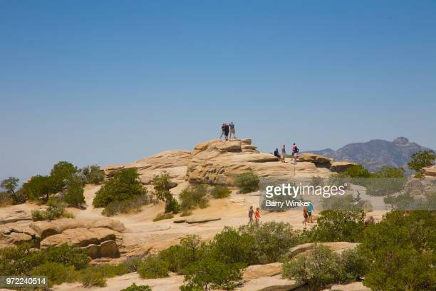 people climbing at windy point on mt. lemmon - mt lemmon stock photos and pictures