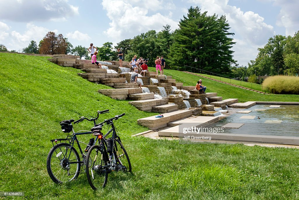 People climbing Government Hill fountain in Forest Park. : News Photo