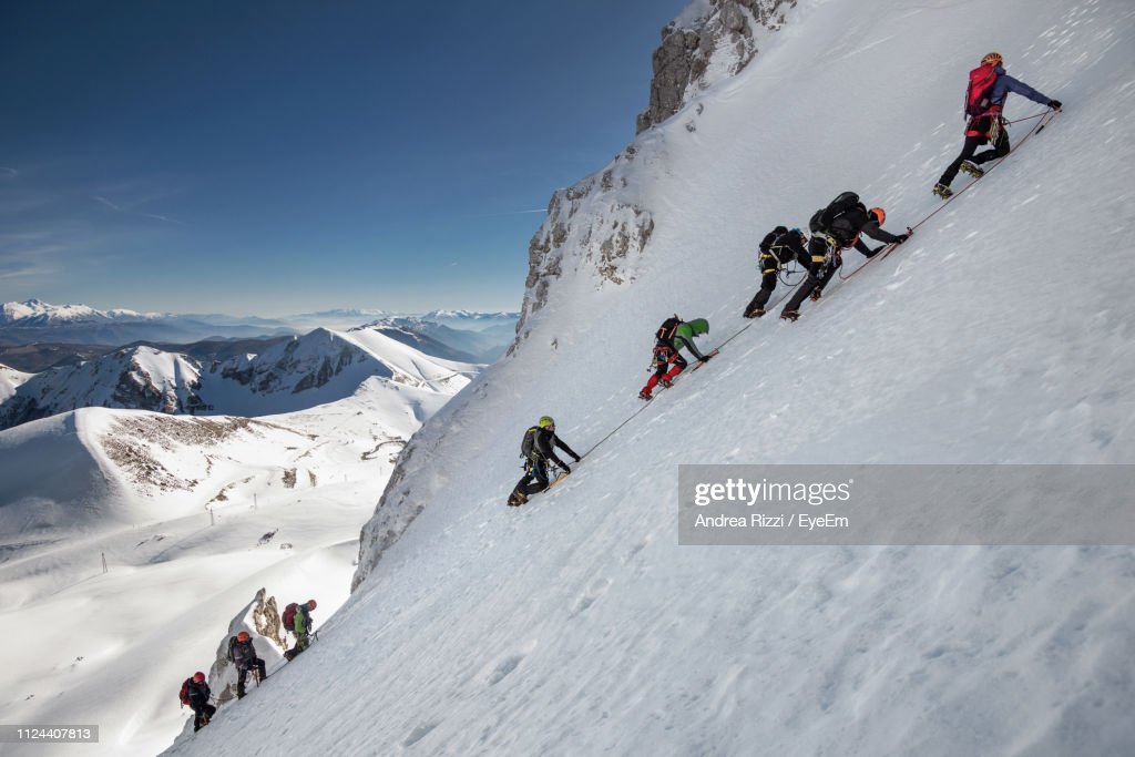 People Climbing On Snowcapped Mountains During Winter : Foto stock