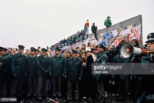 People climbing on the Berlin Wall a few days after its opening on November 9, 1989 when an announcement by the East German government that they...
