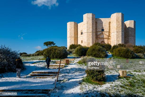 People climbing the hill of Castel del Monte covered with snow from the snowfall of the night on January 18, 2021. The cold wave continues in Puglia,...