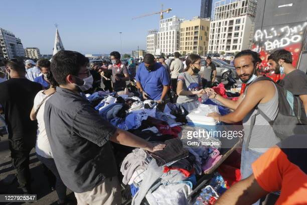 People collect donated items in Martyrs Square to help those affected by the prior days devastating explosion on August 5, 2020 in Beirut, Lebanon....