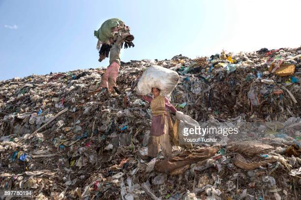 People collect rubbish for resale At the end of the day they earn TK 6080 The Matuail dump yard is one of the three waste sites of Dhaka a city of...