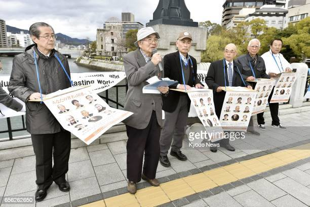 People collect signatures seeking the establishment of a treaty outlawing nuclear weapons in the western Japan city of Hiroshima on March 21 2017 The...