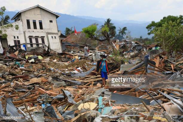 People collect used goods and iron from damaged homes in Petobo Palu central Sulawesi 32 days after quaketsunamiliquefaction hit Central Sulawesi A...