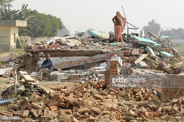 People collecting their belongings from houses demolished in anti-encroachment drive by Greater Noida Authority at Kulsera village on November 17,...