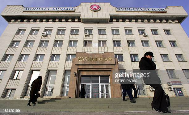 People come and go from the headquarters of the Mongolian People's Revolutionary Party in Ulan Bator 14 January 2006 where Mongolia's former...