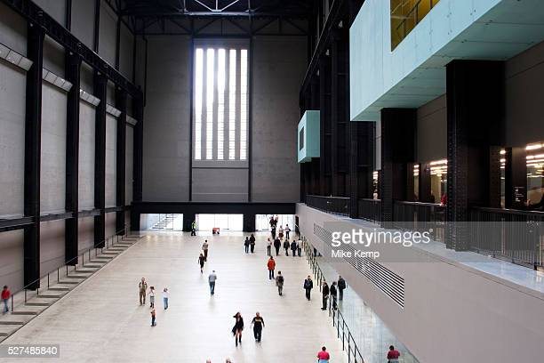 People come and go in the Turbine Hall at the Tate Modern Museum for Modern Art on the south bank of London This has become a cathedral for...
