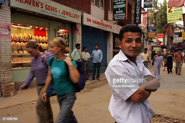 People come back on the streets after the curfew ends in Thamel after the fifth day of an imposed curfew as opposition parties reject King Gyanedra's...