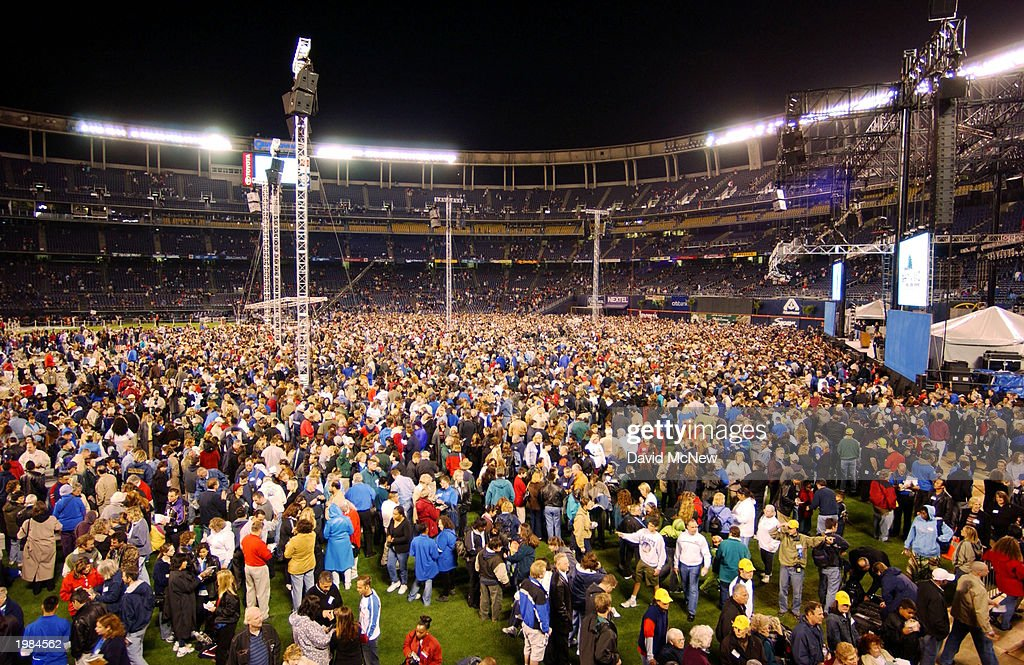 People come forth to 'accept Jesus Christ' in Qualcomm Stadium during the last California mission for America's best known evangelist, 84-year-old Billy Graham, on May 8, 2003 in San Diego, California. Some 54,000 people attended tonight's service which is expected to total 200,000 over the four-night event as thousands convert to Christianity.