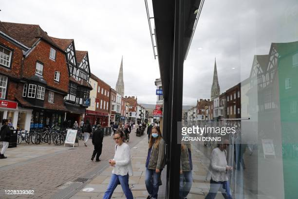 People come out of a shop in the centre of Salisbury southern England on September 4 2020 A long way from the violent cauldron of Russian politics...