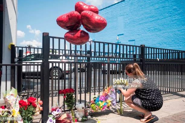 People come to pay their respect to those who lost their lives after the mass shooting over the weekend in Dayton Ohio on August 5 2019 US President...
