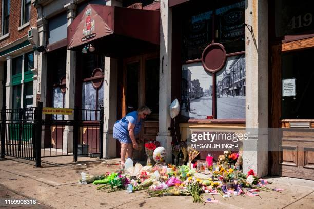 People come to pay their respect to those who lost their lives outside of Ned Peppers bar after the mass shooting over the weekend in Dayton Ohio on...