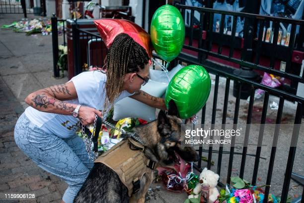 People come to pay their respects to those who lost their lives at the scene mass shooting over the weeeknd in Dayton Ohio on August 5 2019 US...