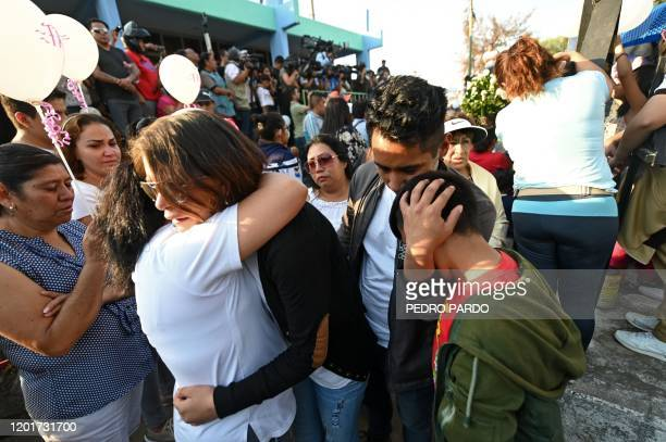 People comfort each other after the burial of a sevenyearold girl whose body was found over the weekend with signs of torture at a cemetery in Mexico...
