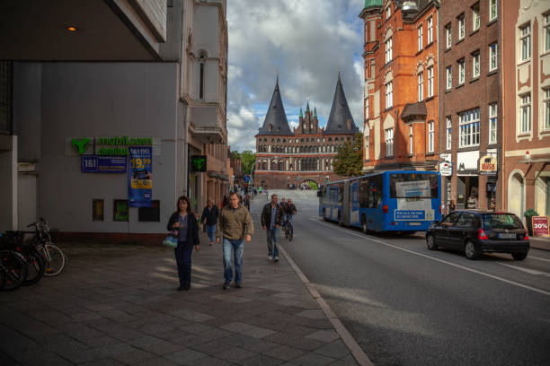 People coming from the Holsten Gate in Lübeck