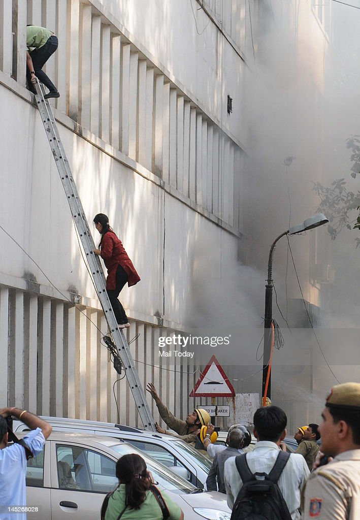 People coming out of Punjab National Bank where a major fire broke out at the Parliament Street in New Delhi on Wednesday