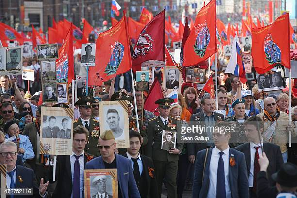 People commemorating Soviet soldiers killed during World War II walk in a remembrance march towards Red Square to as part of Victory Day celebrations...