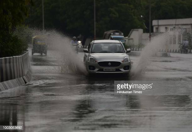 People commute during heavy rain at Sector123 on July 21 2018 in Noida India India Meteorological Department predicted heavy to very heavy rainfall...