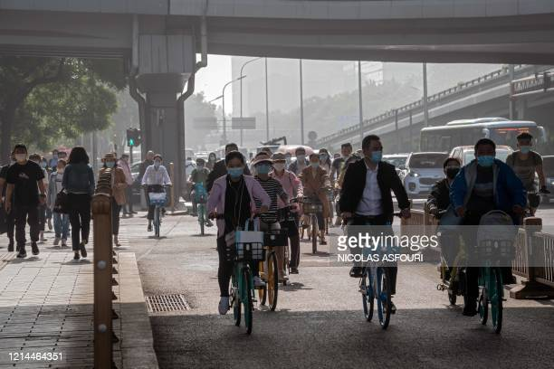 People commute during the morning rush hour in Beijing on May 22 as they city hosts the opening session of the annual National People's Congress . -...