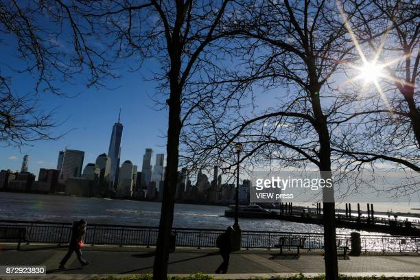 People commute from New Jersey to New York as the skyline of New York city and One World Trade Center are seen along Hudson river during low...