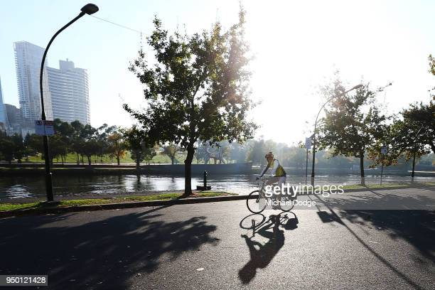 People commute on their bicycles along the banks of the Yarra River on April 23, 2018 in Melbourne, Australia. Melbourne has been experiencing...