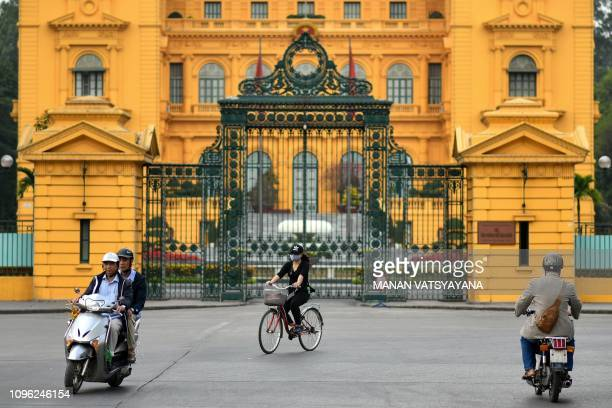 People commute past the Presidential palace in Hanoi on February 9 2019 US President Donald Trump announced on February 8 that his upcoming summit...