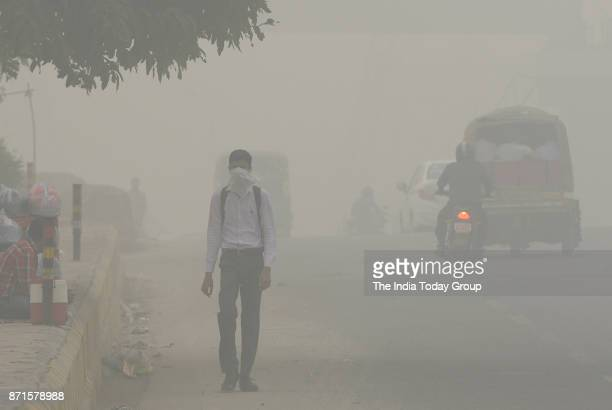People commute through smog in New Delhi